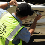 CASA inspector checking small aircraft