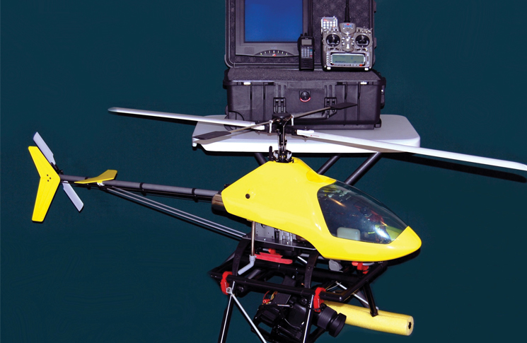 A rotary unmanned aerial system (UAS) comprises of the helicopter UAV, or flight vehicle; the ground station; and the communication or data links.