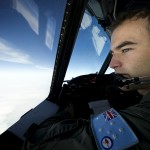 Royal Australian Air Force (RAAF) Pilot Flying Officer Stuart Doubleday conducts an intensive search over the southern Indian Ocean for any sign of Malaysia Airlines flight MH370 from the flight deck of an AP-3C Orion maritime patrol aircraft. Image: © Commonwealth of Australia, Department of Defence