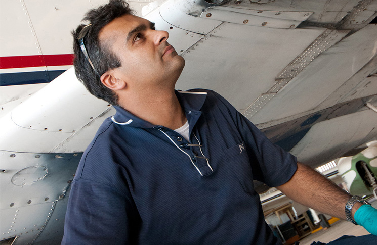 Engineer looking up at aircraft
