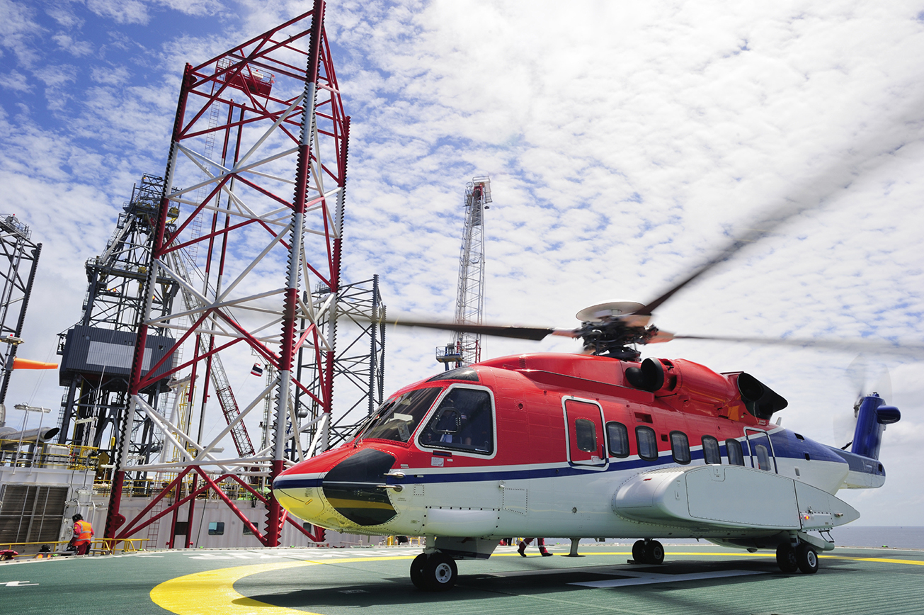 The offshore helicopter for transporting people to an oil rig