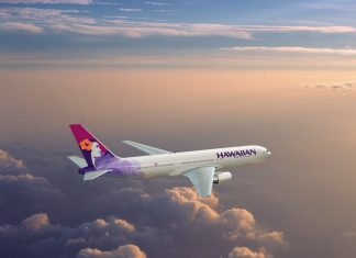 Hawaiian Airlines Boeing 767 flyying through a cloudy sky