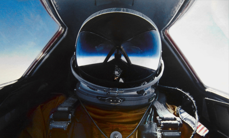 A self-portrait of Brian Shul in full flight suit gear within the cockpit of the SR-71 Blackbird.