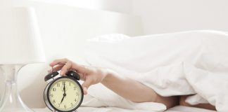 hand stopping alarm clock