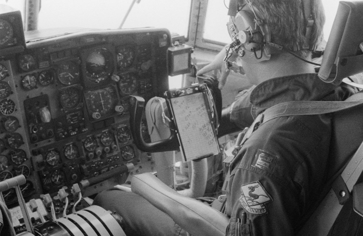 A copilot monitors instruments in the cockpit of a WC-130 Hercules aircraft of the 815th Weather Reconnaissance Squadron, 920th Weather Reconnaissance Group, during an investigation of Hurricane Allen.