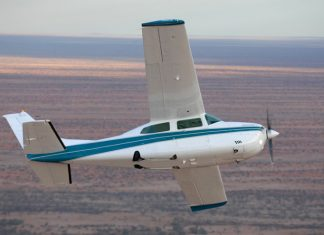 Image of a Cessna 210 aircraft flying