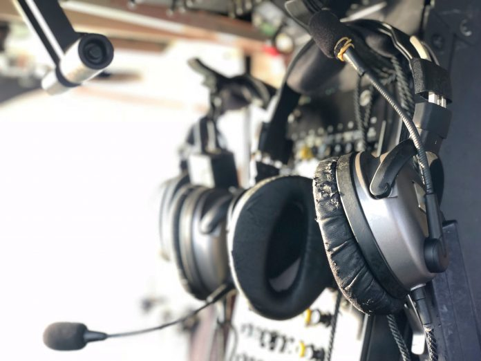 Air traffice control desk and headphones