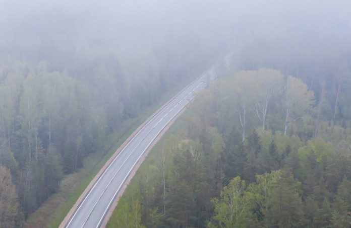 road obscured by low clouds