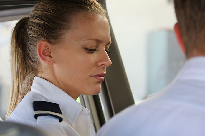 Female pilots in cockpit speaking to instructor