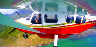 Airvan flying along the coast