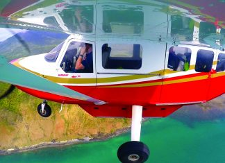 Airvan flying along the coast