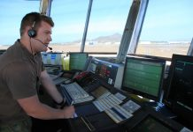 A Royal Australian Air Force (RAAF) air traffic controller in Townsville air traffic control tower
