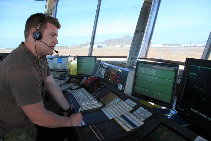 A Royal Australian Air Force (RAAF) air traffic controller in Townsville air traffic control tower