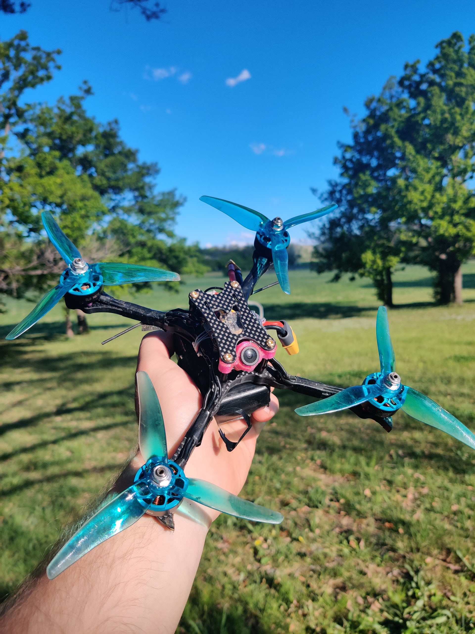 A close-up of an FPV racing drone
