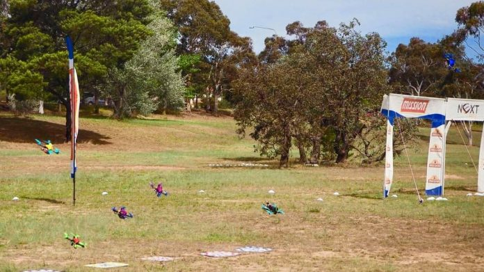 Racing drones taking off from the starting blocks at a Canberra Multirotor Racing Club race day.