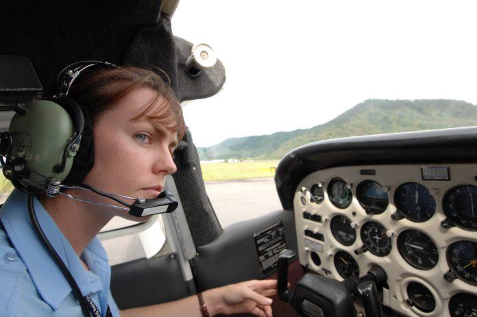 Sally Scott, CFI (Chief Flying Instructor) at North Queensland Aero Club (NQAC) preparing for take off in a Cessna 172N.