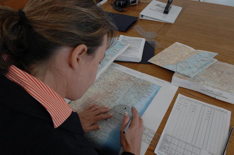 Pilot Salli-Ann Ward doing flight planning. image: © CASA