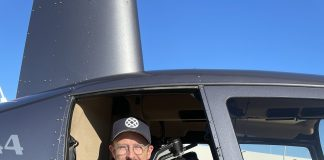 Production Company Owner, Corey Roberts filming from a helicopter in the early days of his career.