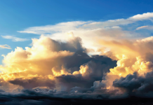 Image of blue sky with storm clouds forming